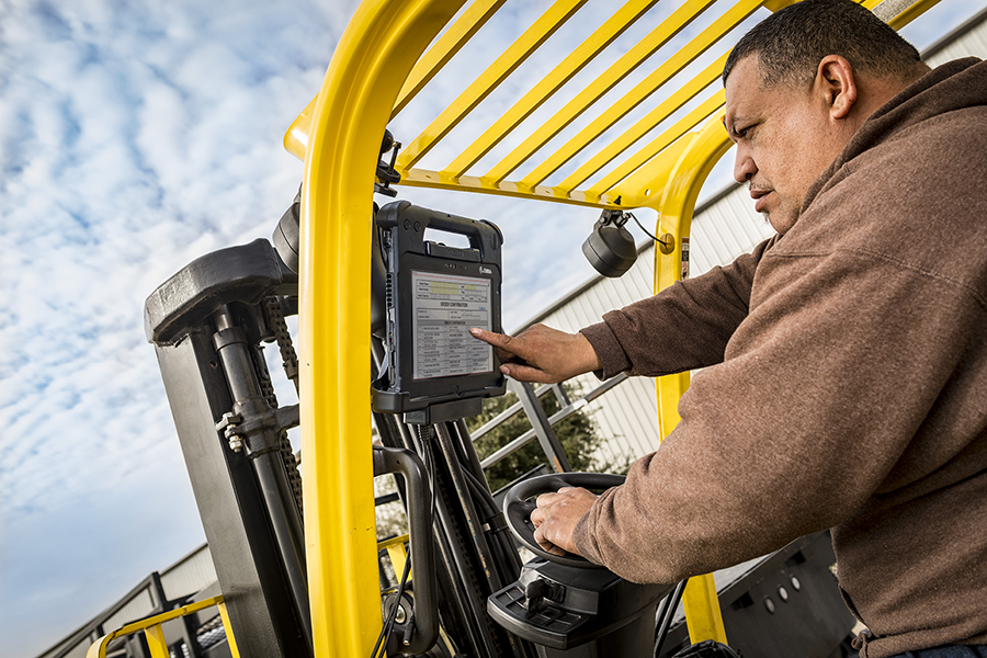 man in forklift using vehicle mounted tablet