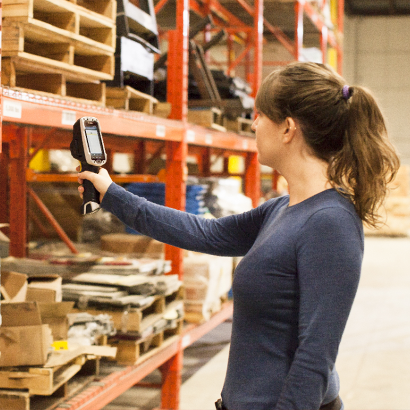 girl in a warehouse using a barcode scanner